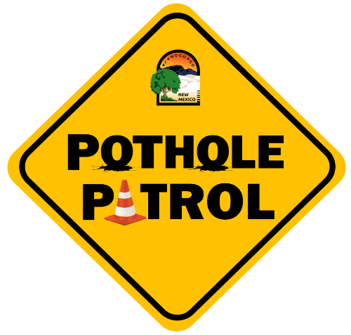 Pothole Patrol logo, Yellow street sign with black text, and City of Alamogordo logo