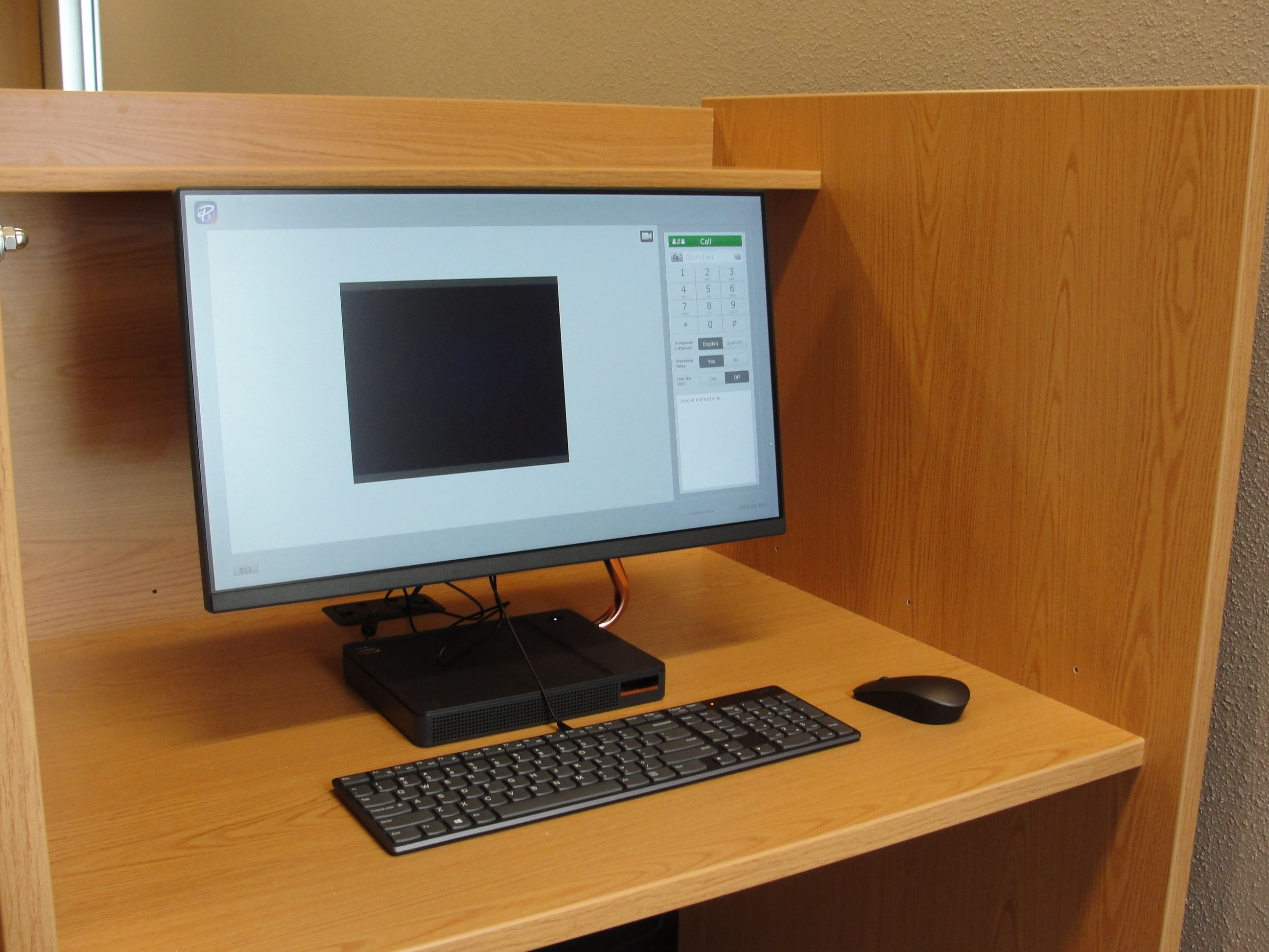 The Video Relay Service computer sitting on a desk at the library.
